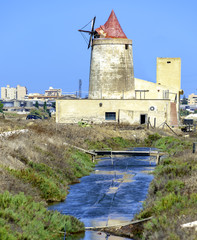Abandoned windmill in the saltworks of Trapani, Sicily - Italy