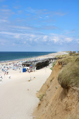 The red cliff at Kampen beach on a sunny summer day at high season on the island of Sylt, Germany