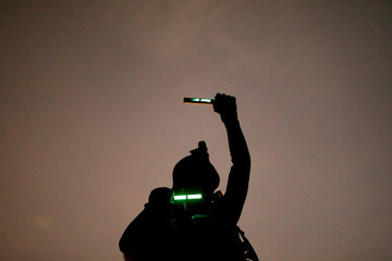 A Taiwanese Marine from Underwater Demolition Company, Amphibious Reconnaissance Patrol Unit (ARP), takes part in a night-time landing training, in Kaohsiung