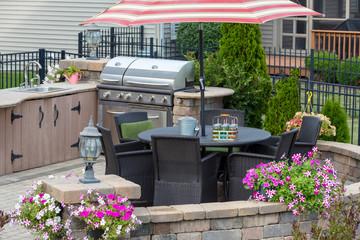 Outdoor kitchen on a brick exterior patio