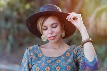 Beautiful Woman Looking Down in a Summer Hat