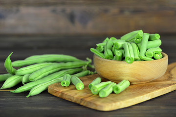 Fresh green beans on wooden table