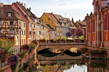 Wall Mural - Evening view with bridge and reflections in the beautiful canals of Colmar, Alsace, France