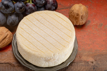 Munster of Pied Angloys, moist, soft, creamy with strong taste, surface-ripened cow's milk cheese made in  France.