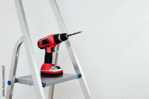 View Of The Driver A Red Cordless Is Placed On Ladder Necessary