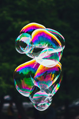 soap bubbles abstract shape, green background