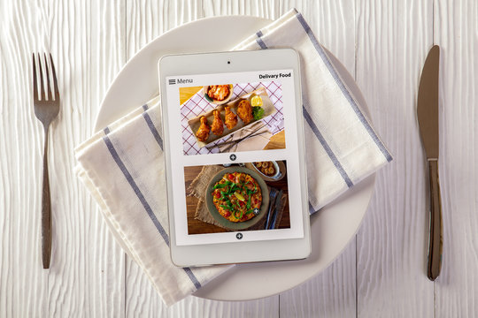 Food delivery concept with a digital tablet