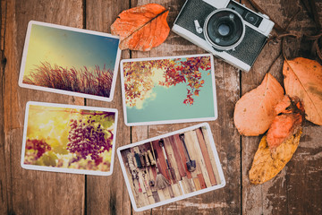 Retro camera and photo of memorie and nostalgia in fall.  Autumn memories concept. vintage color effect.