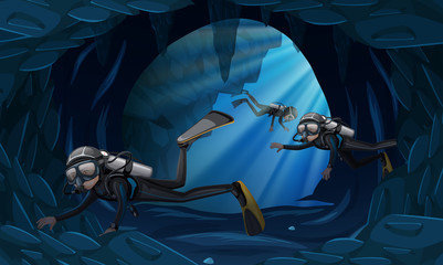 Three divers in a cavern underwater