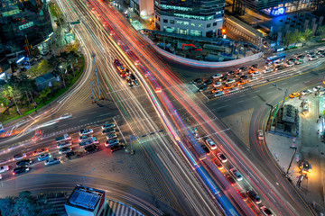 Fototapete - Night scene of light trails traffic speeds through an intersection in Gangnam center business district of Seoul at Seoul city, South Korea.