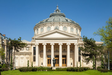 Historical landmark and vintage music hall concept with a daytime view of the Romanian Athenaeum (or Ateneul Roman), opened in 1888 to be the main concert hall in the city of Bucharest, Romania