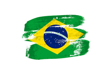 Brazilian flag painted with brush strokes. Vector grunge flag of Brazil isolated on white background.