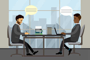 Two businessmen or office manager working and talking in modern office