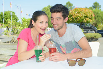 Portrait of couple outside drinking