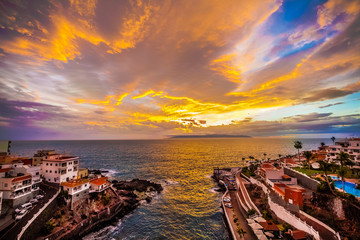 Vibrant sunset over Puerto de Santiago inTenerife island