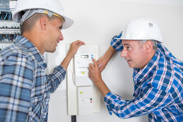builder showing colleague how to control the heating