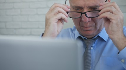 Businessman in Office Put his Eyeglasses and Start Working