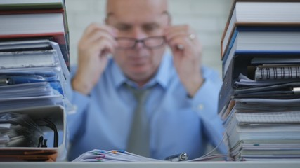 Businessman In Accounting Archive Working With Financial Documents