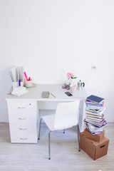 Back to college from holidays. Packing books and education things at home. Workspace with stationery
