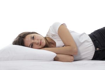 beautiful young girl sleeping on bed