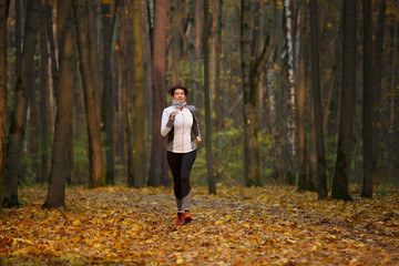 Full-length photo of brunette on morning run