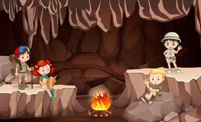 International kids camping in the cave