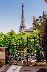Cozy street with view of Paris Eiffel Tower in Paris, France. Eiffel Tower is one of the most iconic landmarks in Paris.