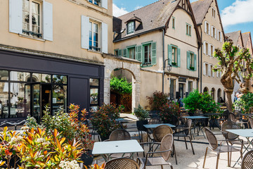 Wall Mural - Old street with old houses and tables of cafe in a small town Chartres, France