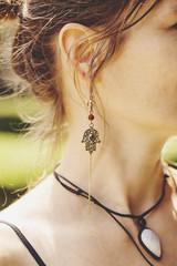 Woman wearing decorative long earrings