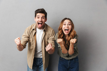 Portrait of a happy young couple screaming