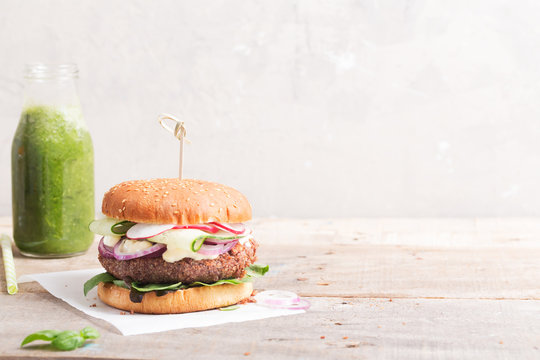 Veggie bean and quinoa burger with fresh vegetables. Copy space