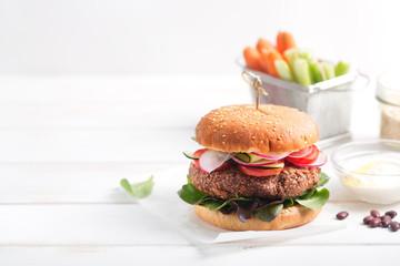 Veggie bean and quinoa burger with fresh vegetables