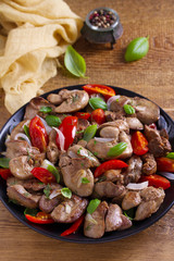 Chicken liver with plum cherry tomatoes, onion and basil