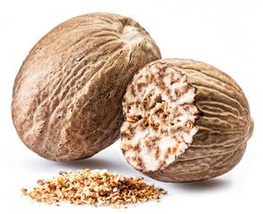 Fototapeta Dried seeds of fragrant nutmeg and grated nutmeg  isolated on white background. obraz
