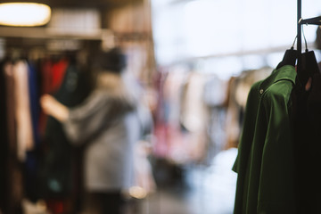 Girl in a clothing store - shopping concept