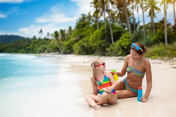 Mother and child on tropical beach