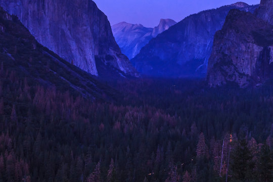 Close up Yosemite National Park Tunnel View overlook at blue hour after sunset. El Capitan and Half Dome at night just after sunset. California, United States.