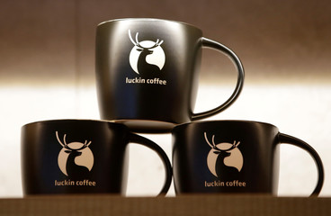 Logos are seen on the cups for sale at a Luckin Coffee store in Beijing