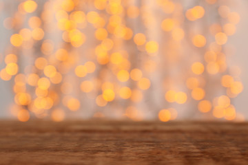 Wall Murals Wooden table and blurred Christmas lights on background