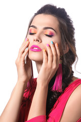 Beautiful young woman with colorful manicure on white background