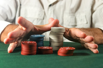 Closeup of hands with gambling tokens