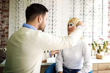 Woman in Optics Store