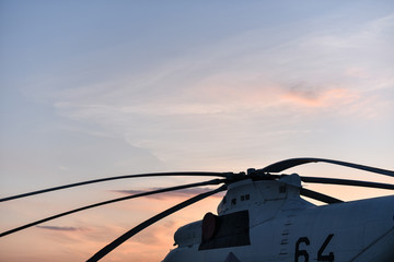 heavy military helicopter on background sunset