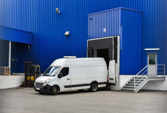 van in loading and unloading commercial cargo in warehouse dock