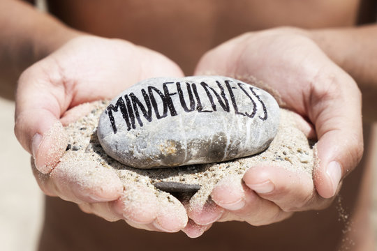 man on the beach and text mindfulness