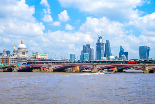 skyline of london city by river thames