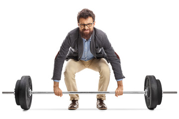 Young man struggling to lift a barbell