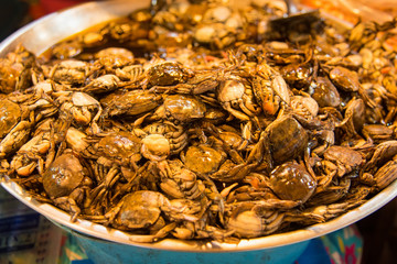 Salted crab in a basin sold in the market.Thailand.