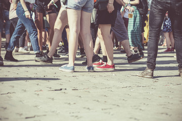 Teenagers at summer festival feet background