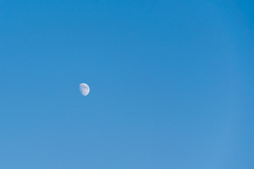half moon in the blue sky